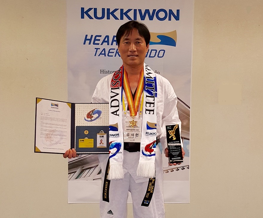GrandMaster Yu with his International Advisory Board recognition, appointment letter, and plaque